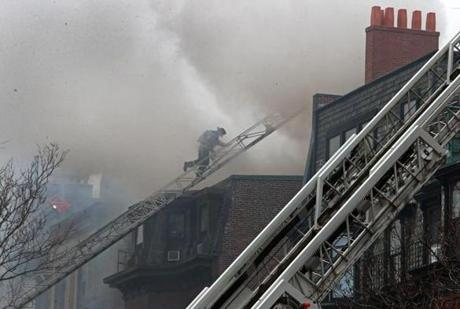 03/26/14: Boston, MA: A nine alarm fire broke out this afternoon at 298 Beacon Street in the Back Bay of Boston. (Jim Davis/Globe Staff) section: metro topic:27fire(3)