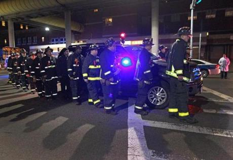 Firefighters escorted the body of a fallen colleague from Boston Medical Center to the Medical Examiner's Office nearby Wednesday night.