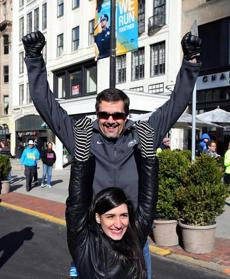 Kevin Corcoran from Lowell and his daughter, Sydney, threw their arms up on Boylston Street.