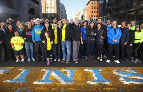 More than 200 people affected by the bombing returned to the finish line of the Boston Marathon for a group portrait.