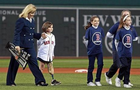 The Richards resisted efforts to make Jane a symbol of resilience, but they agreed to a public appearance when the Red Sox asked Jane's youth choir to sing the national anthem before a playoff game. As long as she wasn't singled out, they thought it would be fine. Of course, Jane was unmistakable as soon as she walked on the field.