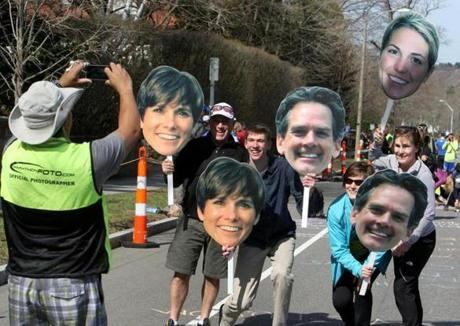 Spectators held signs used to cheer on  runners at Heartbreak Hill.