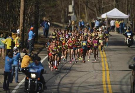 The women's elite runners were packed together in Hopkinton.