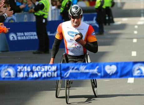 Ernst Van Dyk, of South Africa, crossed the finish line to win the men's wheelchair division.
