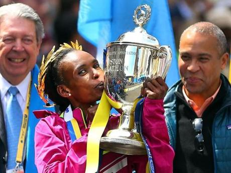 Jeptoo gave some love to her trophy.