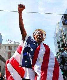 American winner Meb Keflezighi was draped in the flag at the victory ceremony.