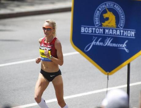 4/21/2014 - Boston, MA - Boylston Street - Shalane Flanagan, cq, came down the home stretch of Boylston Street to finish seventh overall and first for the USA in the Boston Marathon. Officials expected a million spectators to turn out for the 2014 Boston Marathon, on year after the Boston Marathon bombings that killed 3 and injured hundreds. Topic: 21marathonpix. Dina Rudick/Globe Staff.