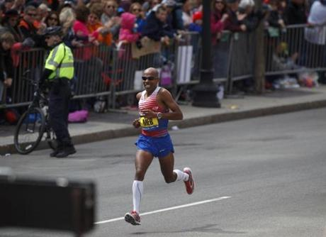 4/21/2014 - Boston, MA - Boylston Street - Meb Keflezighi, cq, (USA) finishing the home stretch on Boylston Street - he cam in first in the Boston Marathon.Officials expected a million spectators to turn out for the 2014 Boston Marathon, on year after the Boston Marathon bombings that killed 3 and injured hundreds. Topic: 21marathonpix. Dina Rudick/Globe Staff.