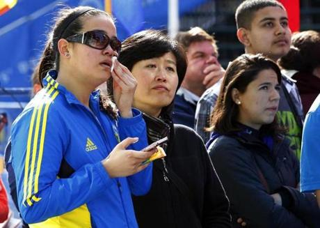Josephine Bouquet, 22, of Maryland, wiped a tear away as she stood beside her mother, Yun, at the finish line before the start of the race. Josephine ran the Marathon last year, but was stopped about a mile from the finish when the bombs went off.