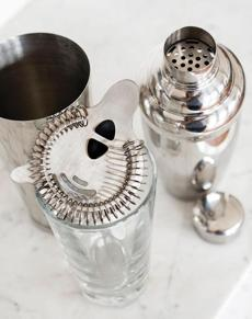 TIP Because smashes can be pulpy, they don't always strain easily. Use a Boston-style shaker (pictured, at left) —comprising two tumblers, usually one metal and the other glass, with a separate strainer. The wire coil strainer allows liquid to pass through more easily than the small holes built into cobbler-style shakers.