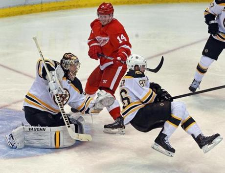 Bruin Kevan Miller sailed in front of his goalie Tuukka Rask as the Red Wings Gustav Nyquist looked on in the third period.