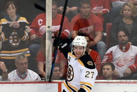 Boston's Dougie Hamilton grinned after he scored in the first period.