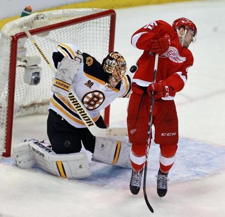 The Red Wings' Riley Sheahan leapt to try and screen Bruins goalie Tuukka Rask in the third period, but the Boston netminder stopped the shot, as he did every one he faced during the game.