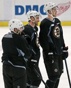 04/23/14: Detroit, MI: Bruins defensemen (left to right), Matt Bartkowski, Johnny Boychuk and Dougie Hamilton hang out together. The Boston Bruins had an optional workout in preparation for for Game Four of their NHL Eastern Conference Quarterfinal Stanley Cup Playoff series vs. the Red Wings at Joe Louis Arena. (Jim Davis/Globe Staff) section: sports topic: Bruins(1)