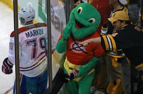 A Bruins fan dressed as a turtle and sweater with  a crossed-out Canadiens logo tried to get the attention of Montreal players during warm-ups.