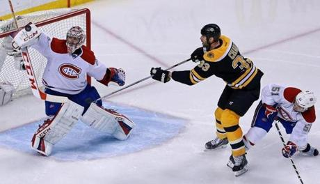 The Bruins' Zdeno Chara tried to redirect a flying puck past Price in the first overtime period, but couldn't connect.