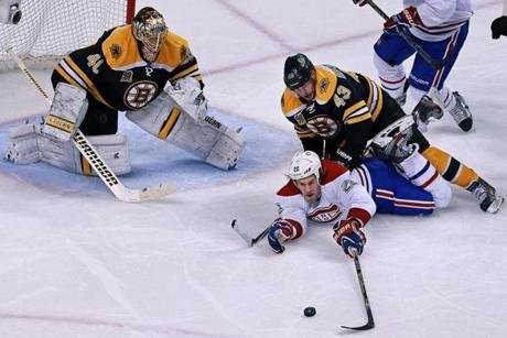 The Bruins' Matt Bartkowski (43) took down the Canadiens' Dale Weise in front of Tuukka Rask early in the second overtime. The penalty set up the game-winning power play goal soon after.