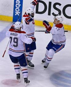 Subban and teammates Andrei Markov (79) and Rene Bourque (17) celebrated their 4-3 victory.