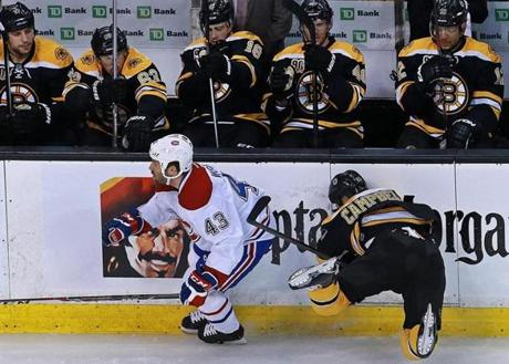 The Bruins Gregory Campbell missed a first period check attempt on Montreal's Mike Weaver, and ended up going face first into the boards.