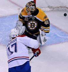 Montreal's Rene Bourque (17) beat Rask in the second period to put his team ahead 2-0.