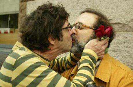 Michael Mullin-Wilde (left) and Larry Mullin-Wilde sealed their marriage with a kiss in Cambridge.