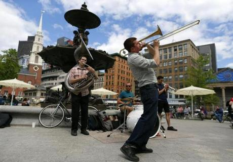 Boston, Massachusetts -- 05/20/2014-- Matt Finstein, 28, of Lower Allston leans back as he plays trombone with bandmates (L-R) John Baylies, 22, of Allston, Matt Salvo, 23, of Waltham and Gabriel Labovitz, 23, of Watertown on the Boston Common in Boston, Massachusetts May 20, 2014. Jessica Rinaldi/Globe Staff Topic: Feature01 Reporter: None