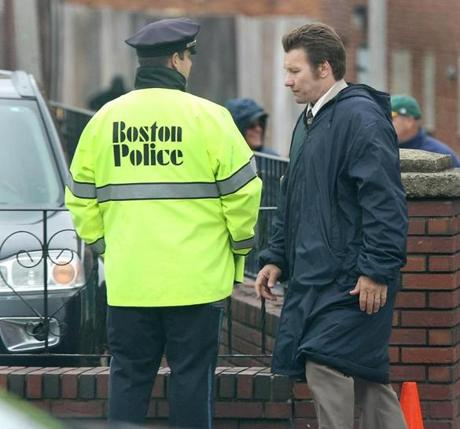 Boston, MA--5/28/2014--Unidentified actor, who continually drove a car up Silver Street, takes a break. The filming of