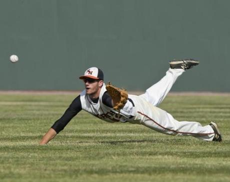 Newton North right fielder Curtis Beatrice's valiant effort did not result in a catch as Silver Lake's William Gallagher doubled during an 8-5 loss to Newton North on June 1.