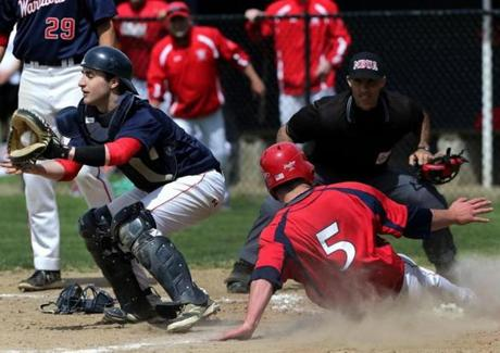 Bridgewater-Raynham's Andrew Noviello beat the throw to the play during a 19-4 win over Lincoln-Sudbury on May 29.