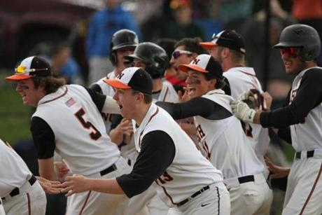 Newton North players celebrated after beating Catholic Memorial 5-4 in the bottom of the 14th inning of a game that was suspended the day prior due to darkness.