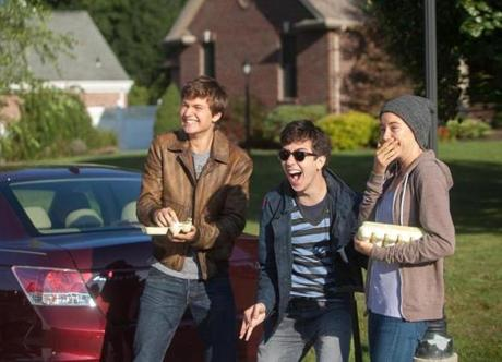 "Gus (Elgort) and Hazel (Woodley) help Isaac (Nat Wolff), their blind friend, as he ""eggs' his ex-girlfriend's car in ""The Fault in Our Stars."""