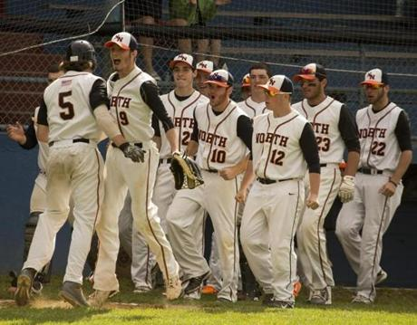Newton North players celebrated after Michael Barbieri (5) scored against Bridgewater-Raynham in a 7-5 win on June 6.