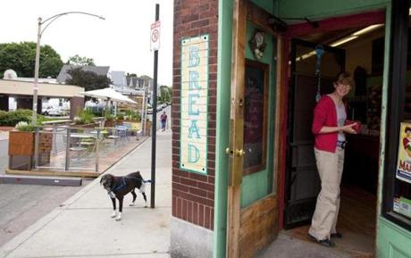 Susan DuPont, of Roslindale, encouraged her dog Leroy to wait patiently while she popped into Fornax Bread Company.