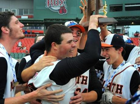 Newton North players lifted the championship trophy after beating Braintree on June 9 to claim the Super 8 title.