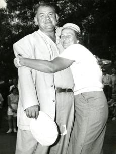 Babe giving a hug to her husband, George, after completing a practice round at the Salem Country Club.
