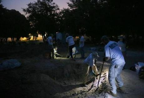 Members of the forensics team began digging in the Falfurrias paupers' gravesite before daylight, in an effort to avoid the brutal afternoon heat that had sickened some the day before.