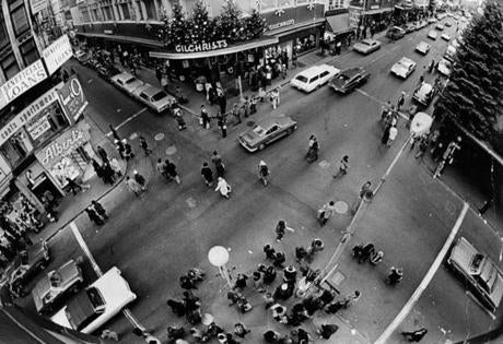 December 24 1973 / fromthearchive / Globe Staff photo by Ellis Herwig / An aerial view of Christmas shoppers at the intersection of Washington and Summer St.