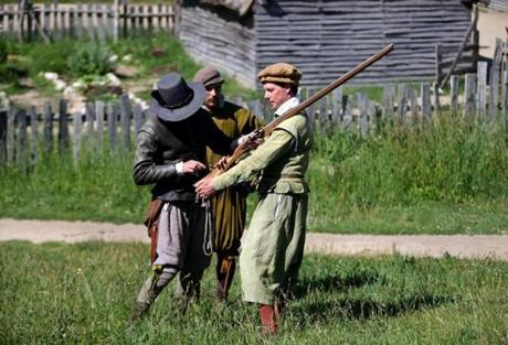 Plymouth Ma 06/21/2014 Plimoth Plantation Chris and Phillip Messier with Reporter Ethan Gilsdorf (cq) right during manual of Arms Training. Boston Globe Staff/Photographer Jonathan Wiggs Topic: Reporter: