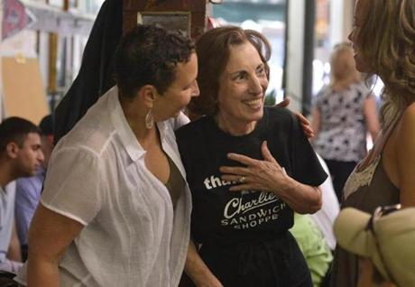Pamela Nunes (left) of Harwich and her daughter Yani Bronson of Detroit joined the crowd in saying farewell to the staff of Charlie's Sandwich Shoppe, the venerated South End eatery on Columbus Avenue that closed its doors after 87 years.