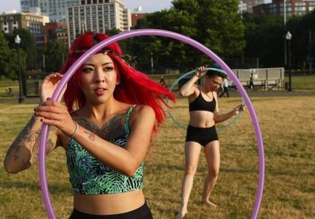 Mulan Duong, 23, (left) of Braintree and Jessica Ferraro, 22, of Las Vegas twirled hula hoops on Boston Common.