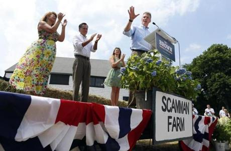 US Senate candidate Scott Brown addressed a campaign crowd at Bittersweet Farm in Stratham, N.H., as his wife, Gail Huff, former Massachusetts governor Mitt Romney, and daughter Arianna Brown applauded.