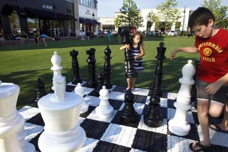 Children play on the green at MarketStreet Lynnfield, the North Shore's largest open air shopping center.
