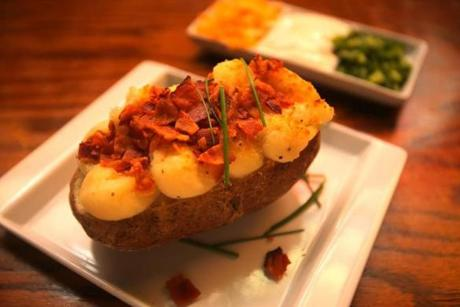 Twice-baked bacon potato with chive sour cream.