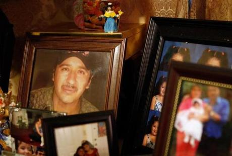 A photo of Santos Interiano sat among other family photographs on a table in the East Boston home of his sister Maria.