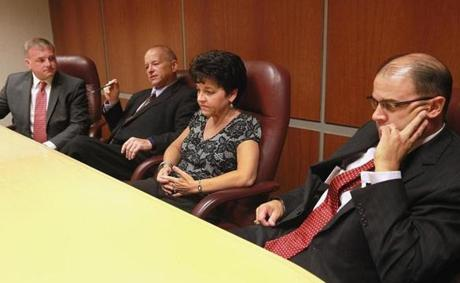 Market Basket executives (from left) Jim Lacourse, Steve Paulenka, Diane Belanger, and Tom Gordon discuss their planned protest at company headquarters in Tewksbury on July 15.