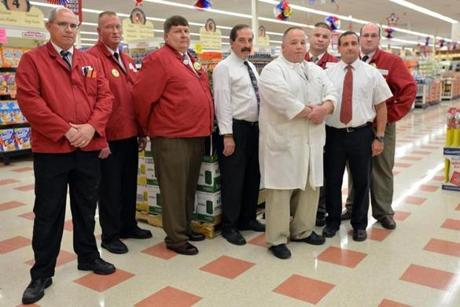 Burlington Market Basket managers (from left): assistant director Sean Dwyer, dairy manager Steve Bond, store director Mark Gouthier, assistant store director Kevin Ralls, meat manager Scott Patenaud, merchandising manager Peter Morris, assistant store director Tony Lissaki, and front-end manager John Garon.