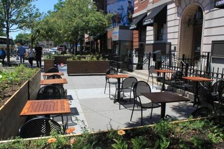 The outdoor patio at the new Brass Union in Somerville has an area for dining and another for playing games.