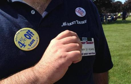 Larry Frost, of Lowell, a cashier at a Billerica store, had a black stripe on his badge in support of Arthur T. Demoulas.