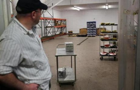 John Garon, a front end manager in Burlington, looked at an empty produce cooler.