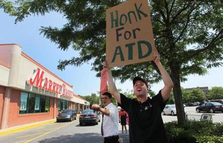 Market Basket workers held signs outside their Stadium Plaza store.